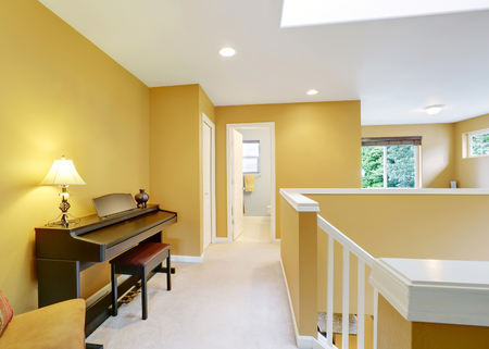 yellow walls: Bright hallway interior with yellow walls and piano . Northwest, USA
