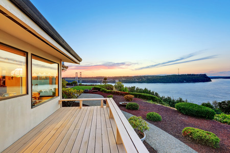 tacoma: Luxury house exterior at sunset. view of wooden deck with walkway. Northwest, USA