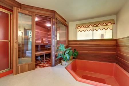 finnish bath: Interior of home wooden sauna cabin with jacuzzi bath. Northwest, USA