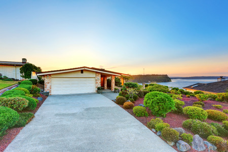 Luxury House exterior. Garage with long concrete driveway. Perfectly trimmed yard. Northwest, USA Stock Photo