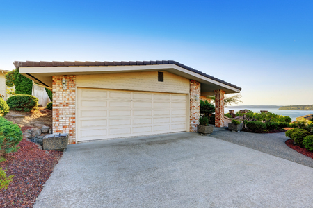 garage on house: Luxury House exterior. Garage with concrete driveway. Northwest, USA Stock Photo