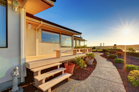 Luxury house exterior at sunset. view of wooden deck with walkway. Northwest, USA
