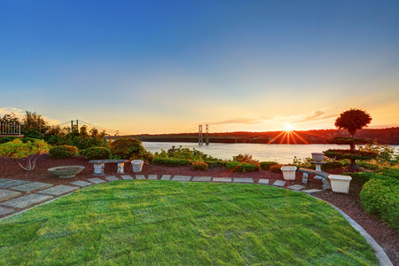 tacoma: Luxury house exterior at sunset. Perfect landscape design. Scenic water view. Northwest, USA
