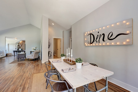 dining table and chairs: View of dining table with wooden top and metal chairs. Open floor plan. Northwest, USA