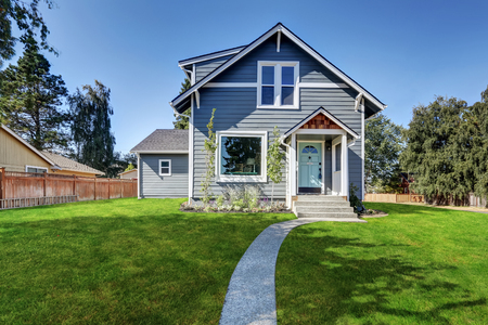 front house: Blue clapboard siding house with grass filled front yard. Northwest, USA Stock Photo