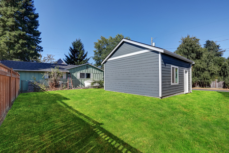 Grass filled back yard with Detached garage. Northwest, USA