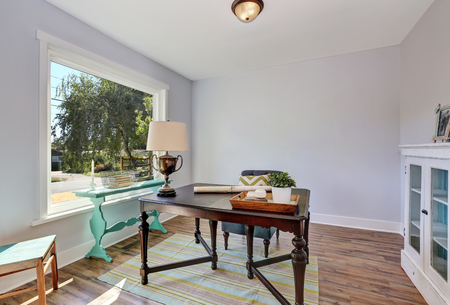 Home office interior. Vintage wooden desk in old style house. Northwest, USA