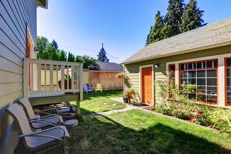 northwest: Backyard view of craftsman house with a shed. Northwest, USA