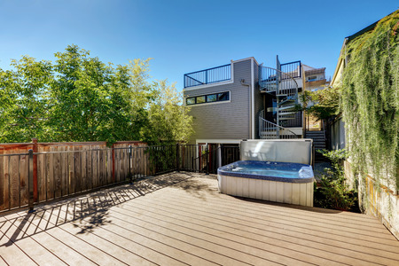 Wooden walkout deck with hot tub. House exterior in Tacoma. Northwest, USA Stock Photo