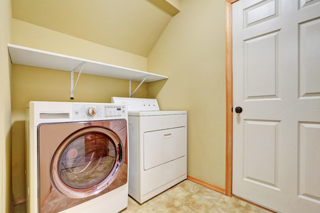 dryer  estate: White appliances in a laundry room with vaulted ceiling. Northwest, USA