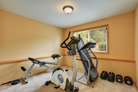northwest: Small gym room with exercise equipments. House interior. Northwest, USA