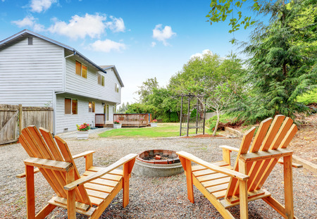 Two lawn chairs with fire pit at the backyard. Blue House exterior. Northwest, USA Imagens