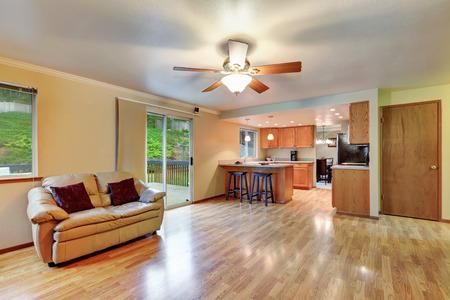 open floor plan: Spacious hardwood living room with open floor plan. Glass door exit to the deck. Kitchen room view. Northwest, USA Stock Photo