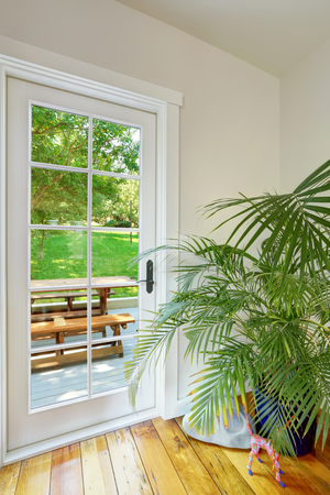 remodeled: View of french door leading to the back yard. House interior. Northwest, USA