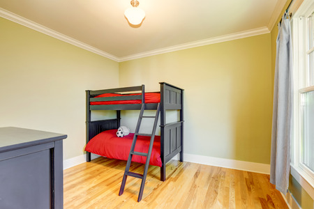 bunk bed: Empty boys bedroom with black bunk bed and red bedding. Hardwood floor and one window. Northwest, USA