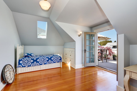 attic: Vaulted ceiling kids bedroom in the attic with open door to the roof terrace. Northwest, USA