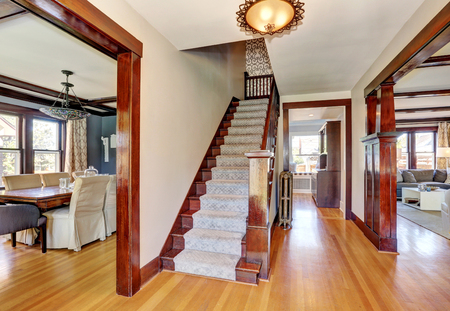 Interior of hallway with staircase and hardwood floor. Open floor plan . Northwest, USA