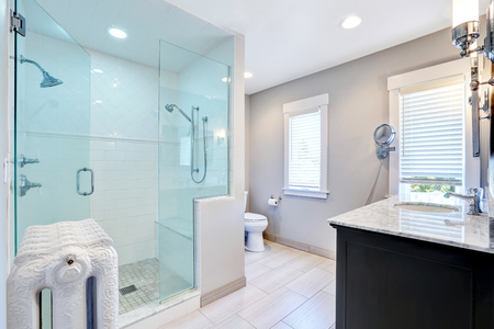walk in: Refreshing bathroom with large glass walk in shower with two heads and cast-iron radiator in retro style. Northwest, USA