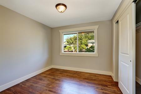 remodeled: Empty room with hardwood parquet floor, window and closet. Northwest, USA