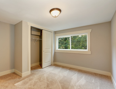 remodeled: Empty room with soft beige carpet floor, window and closet. Northwest, USA
