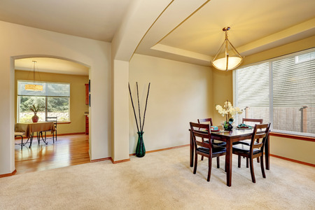 Open floor plan Dining room interior in creamy tones of luxury house. Northwest, USA