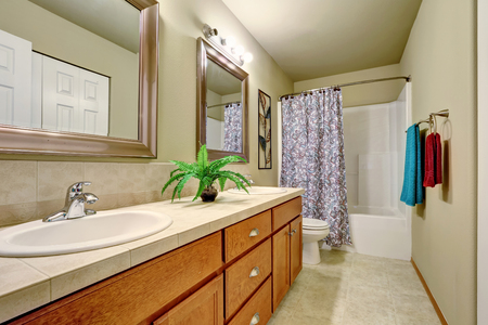 double sink: Long double sink bathroom vanity with drawers and two mirrors. Northwest, USA Stock Photo