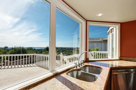 granite kitchen: Granite Kitchen counter with double sink and perfect window view. Interior design. Northwest, USA