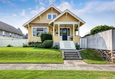 craftsman home exterior american craftsman home with yellow exterior paint and well kept front garden