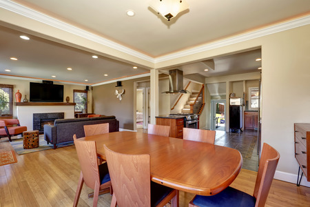 Craftsman kitchen and dining room combo with soft beige walls and hardwood floors. Northwest,USA