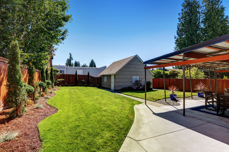 northwest: Backyard area with garage and perfectly trimmed garden. Northwest, USA
