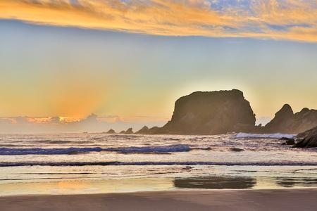 Eroded Cliffs on sunset background . Sandy beach in Westport, New Zealand