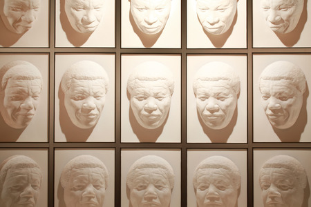 nelson: Wanaka, New Zealand - Febr 5, 2015: hall of following faces at Puzzling world. Illusion room with giant Models of Famous faces. Model of Nelson Mandelas face. Stock Photo