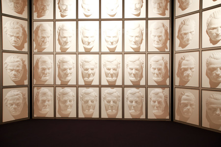 abraham lincoln: Wanaka, New Zealand - Febr 5, 2015: hall of following faces at Puzzling world. Illusion room with giant Models of Famous faces. Masks of Abraham Lincoln and Vincent van Gogh