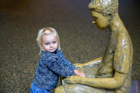puzzling: Wanaka, New Zealand - Febr 5, 2015: pretty little girl by the floating bench in the Sculpt Illusion gallery, Puzzling World.