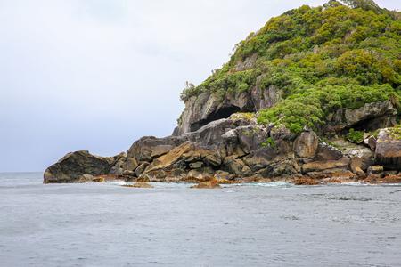 te: Rocky coastline, view from the boat. Te Anau. Fiordland National Park, New Zealand.