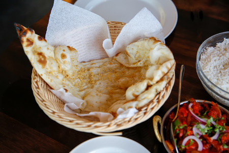 Tasty Steamed rice with fresh tomato sauce and pita bread served in cafe, Timaru, New Zealand