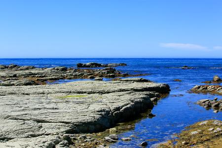 Rocky coast at Kaikoura Peninsula, New Zealand. Stock Photo