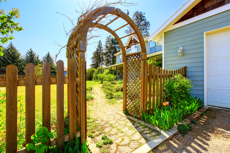bower: View of Wooden arbor and fence. Arched entry to the garden. Northwest, USA