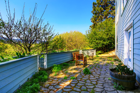 back yard: Back yard with stone tile floor, patio area and wooden raised flower beds. Northwest, USA