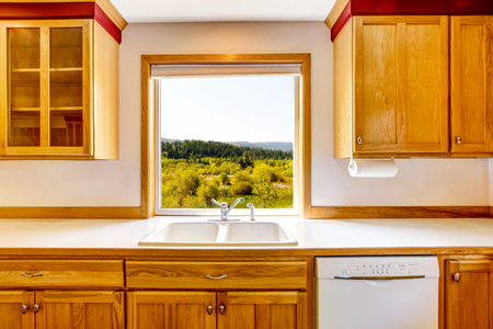 country kitchen: Amazing view from the kitchen window. Country house interior. Northwest, USA