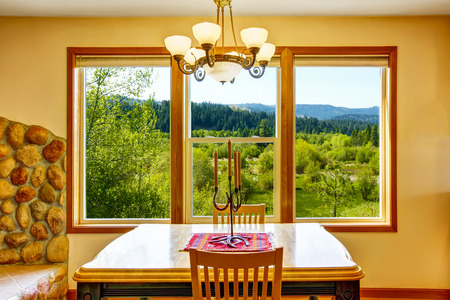 candle holder: Wooden dinner table with candle holder and beautiful view. Northwest, USA Stock Photo