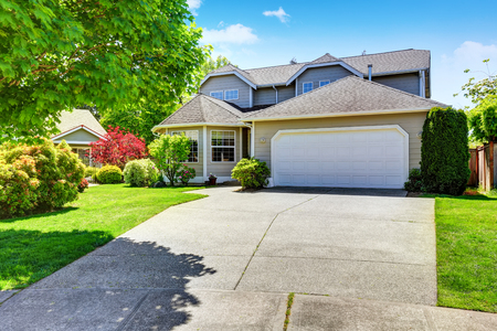 Classic American two story house exterior with garage, driveway and well kept garden. Northwest, USA Stock Photo