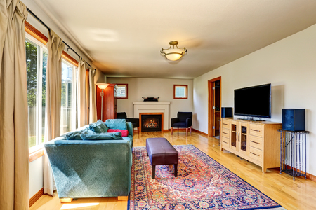 traditional living room: Traditional living room interior with fireplace and rug. Northwest, USA Stock Photo