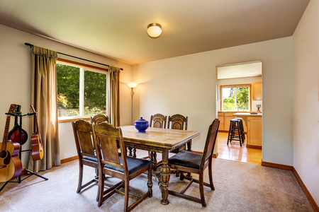 Musicians dining room with carved table set and guitars. Northwest, USA