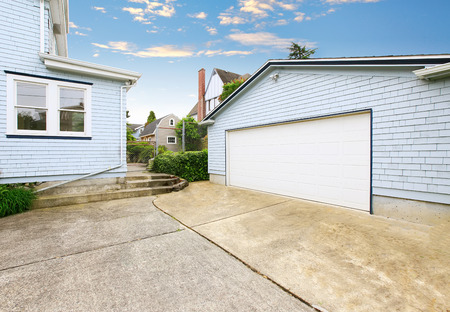white trim: Separate garage with blue and white trim and driveway. Northwest, USA