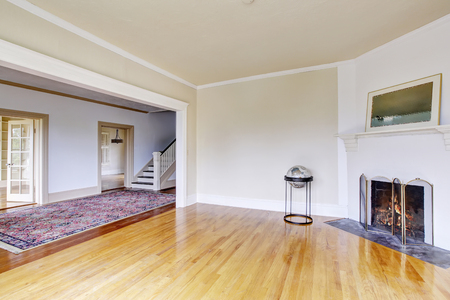 Open floor plan. Empty living room interior in white tones and fireplace. Northwest, USA