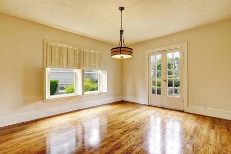 shiny floor: Empty room interior in beige tones and shiny hardwood floor. Northwest, USA