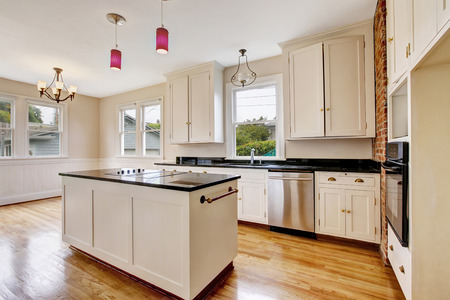 Classic kitchen room interior with white cabinets and dark counter top. Northwest, USA Stock Photo