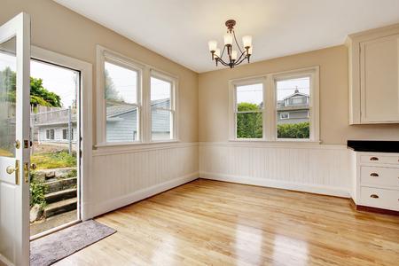 Empty hallway interior with hardwood floor and opened door to backyard. Northwest, USA Stock Photo