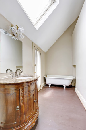 Bathroom interior in white tones with carved vanity cabinet. Northwest, USA